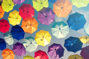 A sky full of opened umbrellas in different colours
