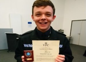 Cadet with certificate smiling